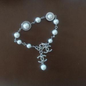 Beautiful chanel pearl bracelet w charms.
